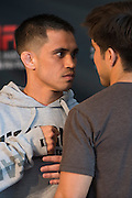 DALLAS, TX - MARCH 12:  Chris Cariaso faces off with Henry Cejudo during the UFC 185 Ultimate Media Day at the American Airlines Center on March 12, 2015 in Dallas, Texas. (Photo by Cooper Neill/Zuffa LLC/Zuffa LLC via Getty Images) *** Local Caption *** Chris Cariaso; Henry Cejudo