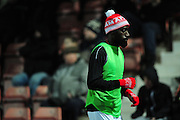 Substitute Adriano Moké of Wrexham warms up during the Vanarama National League match between Wrexham AFC and Kidderminster Harriers at the Glyndŵr University Racecourse Stadium, Wrexham, United Kingdom on 23 February 2016. Photo by Mike Sheridan.
