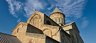 Close up picture & image of the exterior and cupola of the Eastern Orthodox Georgian Svetitskhoveli Cathedral (Cathedral of the Living Pillar) , Mtskheta, Georgia (country). A UNESCO World Heritage Site.<br /> <br /> Currently the second largest church building in Georgia, Svetitskhoveli Cathedral is a masterpiece of Early Medieval architecture completed in 1029 by Georgian architect Arsukisdze on an earlier site dating back toi the 4th century. .<br /> <br /> Visit our MEDIEVAL PHOTO COLLECTIONS for more   photos  to download or buy as prints https://funkystock.photoshelter.com/gallery-collection/Medieval-Middle-Ages-Historic-Places-Arcaeological-Sites-Pictures-Images-of/C0000B5ZA54_WD0s<br /> <br /> Visit our REPUBLIC of GEORGIA HISTORIC PLACES PHOTO COLLECTIONS for more photos to browse, download or buy as wall art prints https://funkystock.photoshelter.com/gallery-collection/Pictures-Images-of-Georgia-Country-Historic-Landmark-Places-Museum-Antiquities/C0000c1oD9eVkh9c