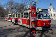 A double tram stops for passengers opposite the Prague Industrial Exhibition Palace in Holesovice district in Prague 7, on 20th March, 2018, in Prague, the Czech Republic.