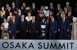 Indonesia's President Joko Widodo, Canada's Prime Minister Justin Trudeau and wife Sophie Gregoire, Giuseppe Conte, South Africa's President Cyril Ramaphosa, China's President Xi Jinping, Germany's Chancellor Angela Merkel, Russia's President Vladimir Putin, Saudi Arabia's Crown Prince Mohammed bin Salman, Japan's Prime Minister Shinzo Abe's wife Akie Abe and Japan's Prime Minister Shinzo Abe and UA President Donald Trump during family photo session on the first day of the G20 summit in Osaka, Japan on June 28, 2019. Photo by Jacques Witt/Pool/ABACAPRESS.COM