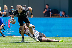 July 22, 2018 - San Francisco, CA, U.S. - SAN FRANCISCO, CA - JULY 22: New Zealand's Tim Mikkelson player is tackled by a Fiji defender during the semifinal match between New Zealand and Fiji at the Rugby World Cup Sevens on July 22, 2018 at AT&T Park in San Francisco, CA. (Photo by Bob Kupbens/Icon Sportswire) (Credit Image: © Bob Kupbens/Icon SMI via ZUMA Press)