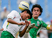 Enrique Alejandro Esqueda of Mexico (R) battles Didi Torrico of Bolivia during the bronze medal match in men's soccer at the Pan American Games in Rio de Janeiro, July 27, 2007.   REUTERS/Jim Young