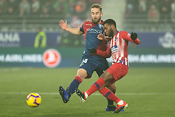 January 19, 2019 - Huesca, Aragon, Spain - Lemar of Atletico de Madrid (11) competes for the ball with Pulido of SD Huesca (14) during the Spanish League football match between SD Huesca andClub Atletico de Madrid at the El Alcoraz stadium in Madrid on January 19, 2019. Atletico wins 0-3. (Credit Image: © Daniel Marzo/Pacific Press via ZUMA Wire)