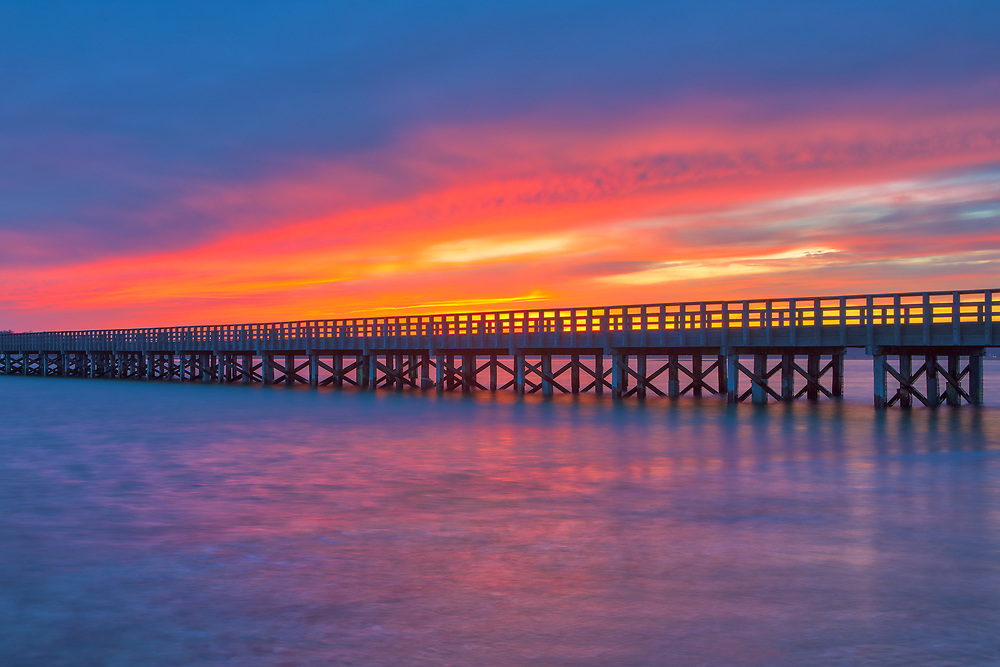New England sunset photography of the Powder Point Bridge in Duxbury, MA. While not the longest and oldest wooden bridge in the world any more, it is still impressive and an adventure to cross over to Duxbury Beach. <br /> <br /> Powder Point Bridge Massachusetts sunset photos are available as museum quality photo, canvas, acrylic, wood or metal prints. Wall art prints may be framed and matted to the individual liking and wall art décor project needs:<br /> <br /> https://juergen-roth.pixels.com/featured/powder-point-bridge-juergen-roth.html<br /> <br /> Good light and happy photo making!<br /> <br /> My best,<br /> <br /> Juergen<br /> Photo Prints & Licensing: http://www.rothgalleries.com<br /> Photo Blog: http://whereintheworldisjuergen.blogspot.com<br /> Instagram: https://www.instagram.com/rothgalleries<br /> Twitter: https://twitter.com/naturefineart<br /> Facebook: https://www.facebook.com