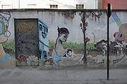 Street art covers a wall in the hilltop neighborhood of Cerro Alegre, Valparaiso.