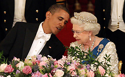 US President Barack Obama speaks to Britain's Queen Elizabeth II during a State Banquet in Buckingham Palace, on the first day of the President's three-day state visit to the UK.