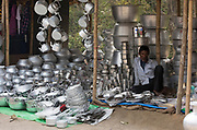 Trading cans and pots on a local marked in Assam, India.