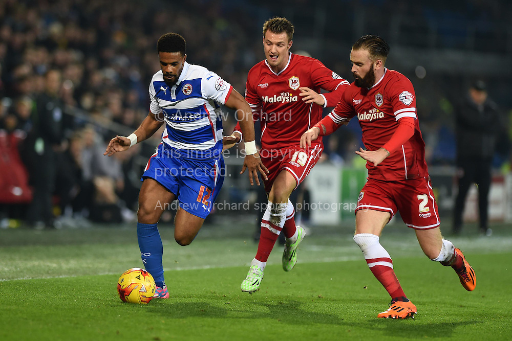Gareth McCleary of Reading (l) looks to go past Cardiff's John Brayford ® and Anthony Pilkington (c) . Skybet football league championship match, Cardiff city v Reading at the Cardiff city stadium in Cardiff, South Wales on Friday 21st November 2014<br /> pic by Andrew Orchard, Andrew Orchard sports photography.