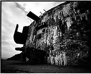THE ATLANTIC WALL. .pic shows: GIANT GUN EMPLACEMENT AT CRAN-AUX-OEUFS SOUTH OF CAP GRIS NEZ BETWEEN CALAIS AND BOULOGNE FROM WHERE 380mm NAVAL GUNS COULD FIRE 800kg SHELLS OF HIGH EXPLOSIVE ACROSS THE ENGLISH CHANNEL..WORLD WAR TWO ENDED IN EUROPE IN MAY 1945, THIS YEAR SEES THE 60th ANNIVERSARY OF THAT VICTORY..THE ATLANTIC WALL BUILT BY GERMANY IN WORLD WAR 2 STRETCHED FROM NORWAY VIA DENMARK, HOLLAND, BELGIUM AND FRANCE TO THE SPANISH BORDER. THE MAIN CONCENTRATION OF BUNKERS,BLOCKHOUSES AND DEFENCES WERE ALONG THE DUTCH, BELGIAN AND FRENCH COASTAL AREAS MOST UNDER THREAT FROM AN ALLIED INVASION. THE CONSTRUCTION OF THE WALL BEGAN IN 1942 AND CONTINUED UP UNTIL THE JUNE 6th ALLIED INVASION ON D-DAY IN 1944..TENS OF THOUSANDS OF WORKERS AND PRISONERS FROM THE GERMAN OCCUPIED AREAS OF EUROPE WERE EMPLOYED BY THE ORGANISATION TODT NAMED AFTER FRITZ TODT, THE GERMAN ENGINEER WHO DIED IN 1942 (TO BE SUCEEDED BY ALBERT SPEER) IN THE BUILDING WORK. BETWEEN THE RIVERS LOIRE AND DIVES 87,257 WORKERS WERE USED INCLUDING 55,000 FRENCHMEN, 11,500 GERMANS, 4,200 DUTCH, 6.600 BELGIANS, 2,600 NORTH AFRICANS AND SEVERAL THOUSAND FROM EASTERN EUROPE..THE ATLANTIC WALL WAS THE LARGEST BUILDING PROJECT SINCE THE ROMAN EMPIRE. MANY OF THE COLOSSAL GUN BUNKERS AND UNDERGROUND DEFENSIVE CHAMBERS REMAIN. SOME HAVE FALLEN FROM CLIFF TOP POSITIONS WHILE OTHERS ARE PARTLY CONSUMED BY SAND DUNES. THE RAVAGES OF WAR, TEN THOUSAND TON BOMBS AND 60 YEARS OF COASTAL WEATHER HAVE HARDLY AFFECTED THESE LEVIATHAN LIKE STRUCTURES WHICH LOOK LIKELY TO LAST AS LONG AS THE RUINS OF ANCIENT ROME. A FITTING REMINDER OF A WORLD THAT COULD HAVE BEEN FROM 60 YEARS AGO..COPYRIGHT PHOTOGRAPH BY BRIAN HARRIS  © 2005.07808-579804