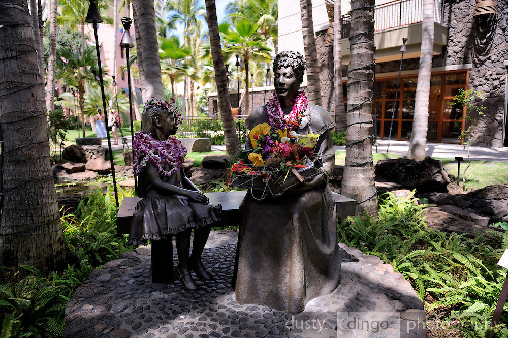 """Bronze statue of Princess Bernice Pauahi Bishop. Unveiled on December 19, 2007 at the Royal Grove, within the Royal Hawaiian Center, as part of the Princess' 176th birthday celebration. The statue was created by Sean K.L. Browne, and is named, """"Ka 'Ikena Ho'oulu a Pauahi"""" (the inspired vision of Pauahi). Waikiki, Honolulu, Hawaii"""