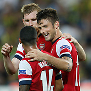 Arsenal's Olivier Giroud (C) celebrate his goal with team mate during the UEFA Champions League Play-Offs First leg soccer match Fenerbahce between Arsenal at Sukru Saracaoglu stadium in Istanbul Turkey on Wednesday 21 August 2013. Photo by Aykut AKICI/TURKPIX