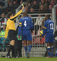 Fotball<br /> Foto: SBI/Digitalsport<br /> NORWAY ONLY<br /> <br /> UEFA Champions league.<br /> PSV Eindhoven v Arsenal<br /> 24/11/2004.<br /> <br /> Arsenal's Lauren recieves his first yellow card