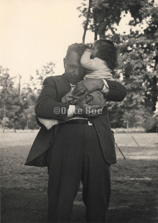 Grandfather holding his grand daughter affectionate