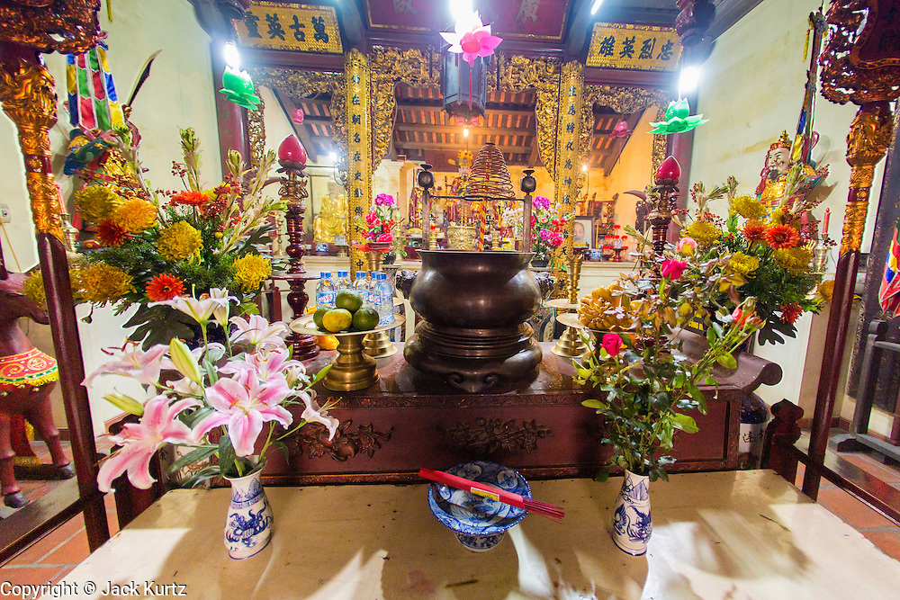 01 APRIL 2012 - HANOI, VIETNAM:   An alter in Chua Cau Dong Temple in Hanoi, the capital of Vietnam. Eastern Gate Pagoda, or Chua Cau Dong, is a temple in the Old Quarter of Hanoi. This elaborately ornate temple is said to be nearly a thousand years old.  PHOTO BY JACK KURTZ