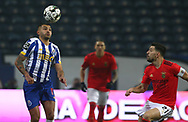 Jesus Corona(Tecatito) of Porto in action with Benfica's Pizzi during the Portuguese First League match between FC Porto and Benfica at Estadio do Dragao, Portugal on 15 January 2021.