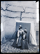 portrait of two fashionable dressed women in daylight outdoor studio setting France ca 1920s