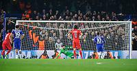 Chelsea's Eden Hazard scores his sides second goal - sending Paris Saint-Germain's Salvatore Sirigu the wrong way - to give them a 2-1 lead over Paris Saint-Germain<br /> <br /> Photographer Ashley Western/CameraSport<br /> <br /> Football - UEFA Champions League Round of 16, Second Leg - Chelsea v Paris Saint-Germain - Wednesday 11th March 2015 - Stamford Bridge - London<br /> <br /> © CameraSport - 43 Linden Ave. Countesthorpe. Leicester. England. LE8 5PG - Tel: +44 (0) 116 277 4147 - admin@camerasport.com - www.camerasport.com