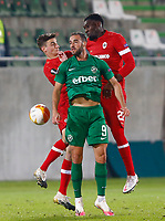 RAZGRAD, BULGARIA - OCTOBER 22: Higinio Marin of Ludogorets competes in the clearing header against Dylan Batubinsika and Pieter Gerkens of Antwerp during the UEFA Europa League Group J stage match between PFC Ludogorets Razgrad and Royal Antwerp at Ludogorets Arena on October 22, 2020 in Razgrad, Bulgaria. (Photo by Nikola Krstic/MB Media)