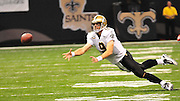 New Orleans Saints QB Drew Brees attempts to throw  a pass the ends up being intercepted by the Atlanta Falcons during the first half of the Siants/Falcons game Sunday Sept. 26,2010. The Super Bowl Champions New Orleans Saints play the Atlanta Falcons Sunday Sept 26, 2010 in New Orleans at the Super Dome in Louisiana.  The Saints and Falcons were tied at half time and went into overtime tied 24-24. Hartley missed a kick to win in overtime, the Falcons went on to win in OT with a field goal 27-24. PHOTO©SuziAltman.com