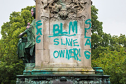 "© Licensed to London News Pictures. 10/06/2020. Leeds UK.  A statue of Queen Victoria at Hyde Park in Leeds has been sprayed with graffiti including the words ""murderer"" and ""slave owner"". The bronze sculpture on Woodhouse Moor in the Hyde Park area of the city also had the words ""coloniser"" and ""racist"" daubed on it.<br /> Several statues have been targeted after a statue of 17th Century slave trader Edward Colston was torn off its plinth in Bristol by protesters. Photo credit: Andrew McCaren/LNP"