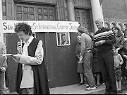"Fr Niall O'Brien Returns from Captivity.1984..14.07.1984..07.14.1984..On 6 May 1983,Fr Niall O'Brien was arrested along with two other priests, Fr. Brian Gore, an Australian, Fr. Vicente Dangan, a Filipino and six lay workers - the so-called ""Negros Nine"", for the murders of Mayor Pablo Sola of Kabankalan and four companions. The priests where held under house arrest for eight months but ""escaped"" to prison in Bacolod City, the provincial capital, where they felt they would be safer.The case received widespread publicity in Ireland and Australia, the home of one of the co-accused priests, Fr. Brian Gore. When Ronald Reagan visited Ireland in 1984, he was asked on Irish TV how he could help the missionary priest's situation. A phone call the next day from the Reagan administration to Ferdinand Marcos resulted in Marcos offering a pardon to Fr. O'Brien and his co-accused..(Ref Wikipedia)...Picture shows Fr Niall O'Brien being ceremonially imprisioned at Sean McDermott Street Church, Fr Mick Casey is seen on the right."