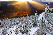 Sunbeams over the Yaak Valley from the Mount Henry Roadless Area in fall. Kootenai National Forest, Purcell Mountains, northwest Montana.