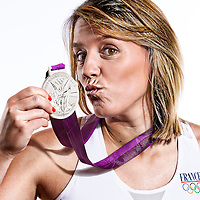 14 August 2012:  Olympic Silver Medalist Marion Laborde (Team France Basketball) poses with her silver medal, at the Hotel Concorde Lafayette, in Paris, France.