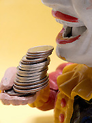 clown doll figure coin bank bringing money to its mouth