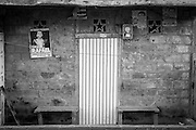 """2015/03/12 - Pile, Ecuador: Door of house decorated with an image of President Rafael Correa in the quiet village of Pile in the Manabí province. Correa set a school to teach children on how to weave the Montecrisit hats in order that the tradition is not lost. The village is far from any modernity. It's main production it is still the """"Montecristi hats"""", commonly known internationally as the """"Panamá Hats"""". The number of craftsmen in the village is declining. Competition from China and the Ecuadorian city of Cuenca that have bigger production and cheaper prices, make hard to make a living to the craftsmen of Pile."""