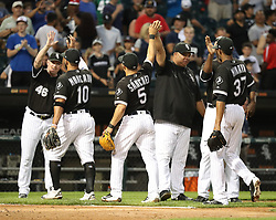 August 21, 2017 - Chicago, IL, USA - Chicago White Sox players and coaches celebrate at the end of their team's 7-6 win over the Minnesota Twins in game one of their double-header on Monday, Aug. 21, 2017 at Guaranteed Rate Field in Chicago, Ill. (Credit Image: © Nuccio Dinuzzo/TNS via ZUMA Wire)
