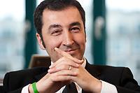 05 JAN 2012, BERLIN/GERMANY:<br /> Cem Oezdemir, B90/Gruene Bundesvorsitzender, waerhend einem Interview, in seinem Buero, Bundesgeschaeftsstelle Buendnis 90 / Die Gruenen<br /> IMAGE: 20120105-01-009<br /> KEYWORDS: Cem Özdemir, Büro