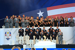 The USA team, with their wives and girlfriends behind, stand in front of the Ryder Cup during the Ryder Cup Opening Ceremony at Le Golf National, Saint-Quentin-en-Yvelines, Paris.