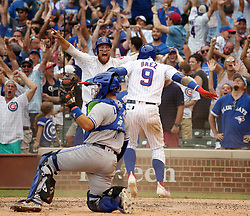 August 20, 2017 - Chicago, IL, USA - Chicago Cubs second baseman Ben Zobrist and Javier Baez (9) celebrate as they score behind Toronto Blue Jays catcher Raffy Lopez (1) in the 10th inning for a walk-off win on Sunday, Aug. 20, 2017 at Wrigley Field in Chicago, Ill. The Cubs defeated the Blue Jays, 6-4, in 10 innings. (Credit Image: © Brian Cassella/TNS via ZUMA Wire)