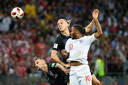 July 11, 2018 - Moscow, Russia - 180711 Mario Mandzukic and Domagoj Vida of Croatia competes for the ball with Raheem Sterling of England during the FIFA World Cup semi final match between Croatia and England on July 11, 2018 in Moscow..Photo: Petter Arvidson / BILDBYRÃ…N / kod PA / 92085 (Credit Image: © Petter Arvidson/Bildbyran via ZUMA Press)