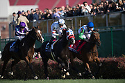 November 3, 2018: Breeders' Cup Horse Racing World Championships. Happily (3), Next Shares (2) and One Master (1) gallop past the finish in the Breeders' Cup Mile.