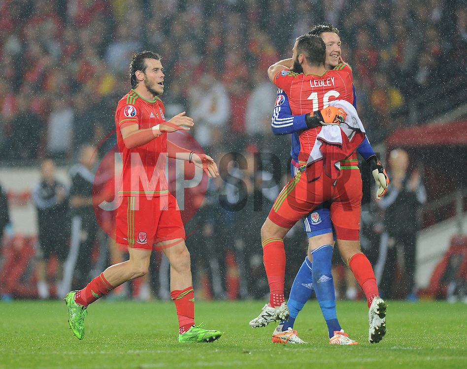 Gareth Bale of Wales (Real Madrid) runs in to celebrate with Joe Ledley of Wales (Crystal Palace) and Wayne Hennessey of Wales (Crystal Palace) - Photo mandatory by-line: Alex James/JMP - Mobile: 07966 386802 - 12/06/2015 - SPORT - Football - Cardiff - Cardiff City Stadium - Wales v Belgium - Euro 2016 qualifier