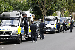 © Licensed to London News Pictures. 31/08/2020. London, UK. Lines of police vans wait in a side street in Notting Hill, West London, on the day of the 2020 Notting Hill Carnival, which is being held virtually this year due to COVID-19 restrictions. Members of the public have been warned against congregating in the Notting Hill Area to celebrate the event. Photo credit: Peter Macdiarmid/LNP
