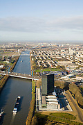 Nederland, Utrecht, Utrecht, 25-11-2008; Utrecht-West met Westraven, het gerenoveerde hoofdkantoor van Rijkswaterstaat, aan het Amsterdam-Rijnkanaal en Galecopperbrug over de A12links van het kanaal Papendorp (kantorenpark) met Prins Clausbrug, rechts de IKEA op de meubelboulevard op Kanaleneiland.achter Kanaleneiland - middenplan, de wijk Oog in Al, aan de verre horizon de skyline van Amsterdam.West Utrecht with Westraven, the renovated headquarters of Rijkswaterstaat, located on the Amsterdam-Rhine Canal, left of the canal Papendorp (office park), to tht right IKEA (at shopping mall) and the neighborhood Kanaleneiland , at the distant horizon, the skyline of Amsterdam;.in het kantoorgebouw  Westraven, naar ontwerp van architectenbureau Cepezedzijn gevestigd de Bouwdienst (ingenieursbureau), de Regionale Dienst Utrecht (Dienstkring) en het LEF future center (studiecentrum, informatiecentrum)in the office building, designed by CEPEZED, are located the Building Service (Engineering Deaprtment), the Regional Service Utrecht and the LEF future center (study center, information center)kantoortoren, kantorencomplex, office tower, office complex. ;. .luchtfoto (toeslag)aerial photo (additional fee required).foto Siebe Swart / photo Siebe Swart
