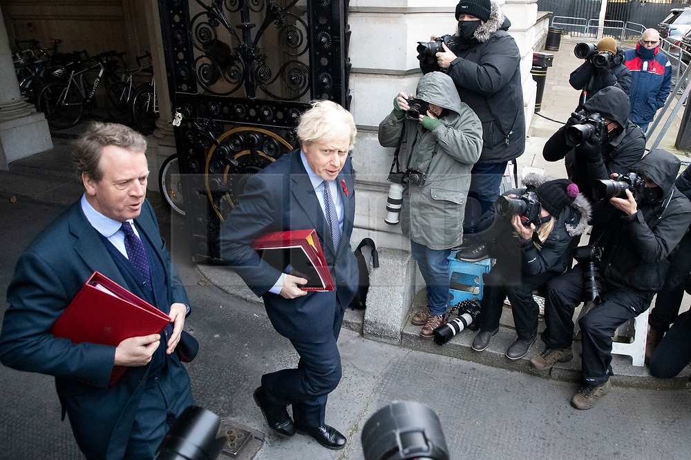© Licensed to London News Pictures. 01/12/2020. London, UK. Secretary of State for Scotland Alister Jack(L)  and Prime Minster Boris Johnson(R) return to Downing Street following a Cabinet Meeting at the Foreign, Commonwealth and Development Office. Later today MPs will vote on new Coronavirus restrictions. Photo credit: George Cracknell Wright/LNP