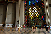 The baptistry window designed by John Piper and made by Patrick Reyntiens inside Coventry Cathedral also known as St Michaels, a modern cathedral founded in 1956 and well known for having stunning modernist stained glass, minimalist structure and large scale tapestry on 23rd June 2021 in Coventry, United Kingdom. The Cathedral Church of Saint Michael, commonly known as Coventry Cathedral, is the seat of the Bishop of Coventry and the Diocese of Coventry within the Church of England. The current St Michaels Cathedral, built next to the remains of the old, was designed by Basil Spence and Arup, built by John Laing and is a Grade I listed building.
