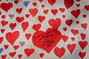 Red hearts that form the National Covid Memorial Wall, a tribute to the 150,000-plus British victims of the Coronavirus pandemic on 30th March 2021, in London, United Kingdom. Bereaved family and friends of Covid-19 victims have started working on the wall located outside St Thomas Hospital. Christine Elizabeth Short is mentioned as succumbing in November 2020.