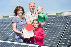 Young family two kids baby solar renewable energy