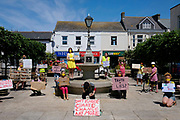 Climate change activists from Extinction Rebellion in the seaside town of Camborne in Cornwall social distancing protesting outside the offices of George Eustice as they believe he does not have the rural communities interests at heart on the 30th of May 2020 in Camborne, United Kingdom. Mr Eustice is the Secretary of State for Environment, Food and Rural Affairs. Prime Minister Boris Johnson has appointed Cornish MP George Eustice, a pro-Brexit former farming minister, as new Environment Secretary. Eustice has been described as a 'real countryman' but has a patchy voting record on climate action. He has been given the role after working as a junior minister in the Department for Environment, Food and Rural Affairs, DEFRA since 2015.