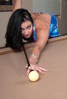 Very sexy girl playing pool and flirting.