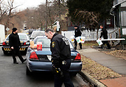 Ithaca, NY, Police Officer, Dana Haff, center, and other law enforcement personnel remove drugs found after an early morning raid at a home in Ithaca, NY, Friday, March 4, 2016. TThe City of Ithaca recently unveiled a new drug policy calling for supervised heroin injection sites and heroin maintenance therapy, which are pieces of the four pillars of change proposed.<br /> (Heather Ainsworth for The New York Times)