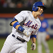 NEW YORK, NEW YORK - July 01: The delighted expression of Brandon Nimmo #9 of the New York Mets as he rounds third base after hitting his first MLB home run, a three run homer in the fourth inning during the Chicago Cubs Vs New York Mets regular season MLB game at Citi Field on July 01, 2016 in New York City. (Photo by Tim Clayton/Corbis via Getty Images)