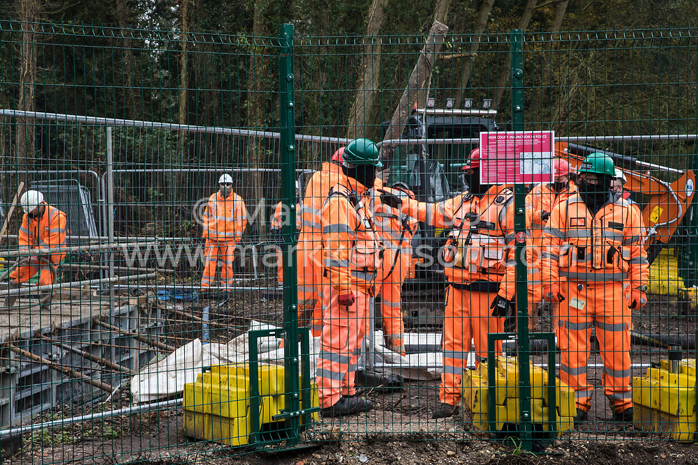 Denham, UK. 5th November, 2020. HS2 security guards monitor bridge building works for the HS2 high-speed rail link at Denham Ford on the first day of the second national coronavirus lockdown. Prime Minister Boris Johnson has advised that construction work may continue during the second lockdown but those working on construction projects are required to adhere to Site Operating Procedures including social distancing guidelines to help prevent the spread of COVID-19.