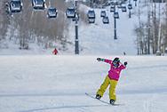 CarrieAnn Grayson plays on her snowboard at Snowmass.