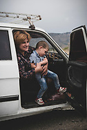 An Armenian family pulls over to the side of a road to tell two foreign hitchhikers that they are sorry they don't have room to give them a lift. Near Agdam, Nagorno-Karabakh.<br /> <br /> (September 24, 2016)